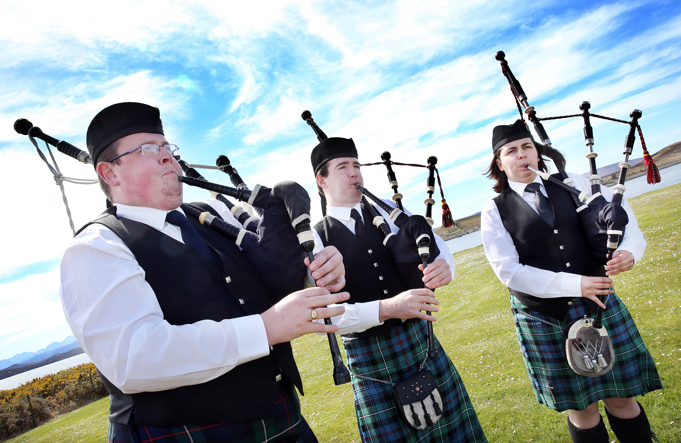 Pipers from the Gairloch and districr pipe band tune-up before taking center stage at Aultbea on Saturday.