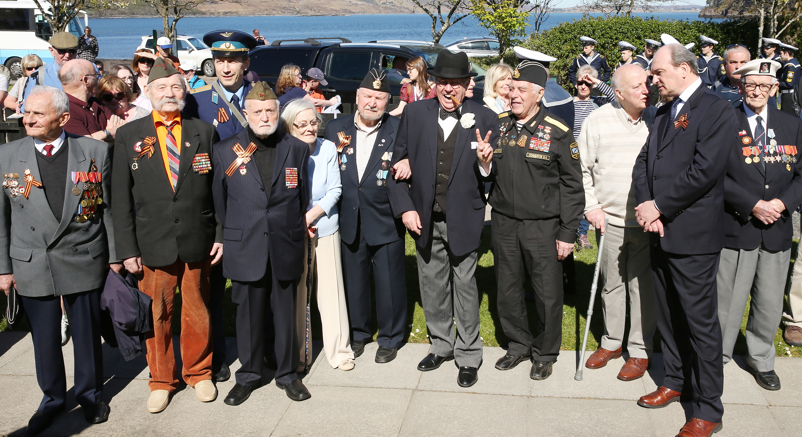 Some of the Arctic Convoy veterans from Russia and the UK, line up for the camera with Russian consul general Andrey Pritsepokev and 'Winston Churchill' Richard Gumm.