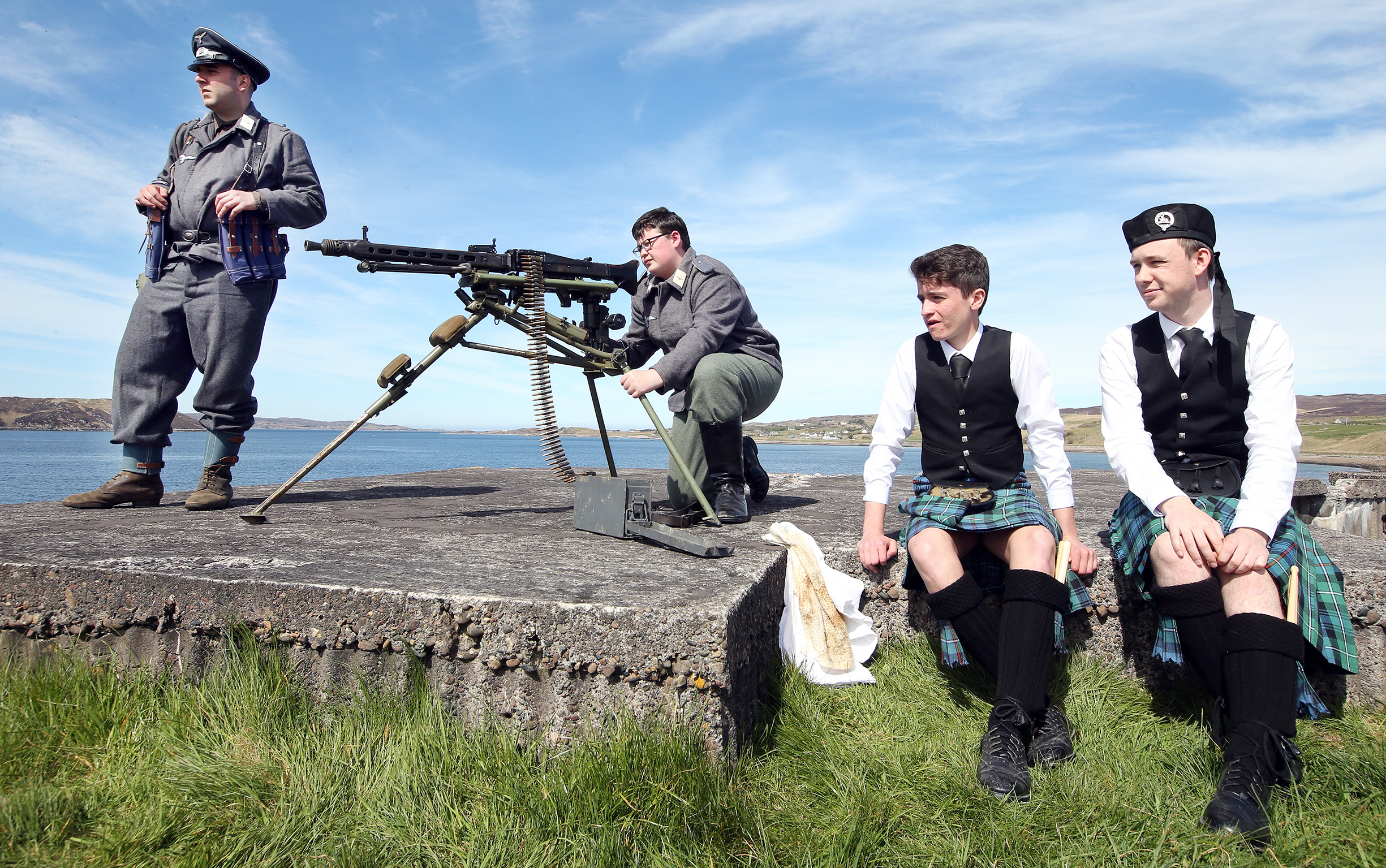 Cameron Walton and Max Conway from the Gairloch and District Pipe Band take in the proceedings from a gun tower on the shores of Loch Ewe.