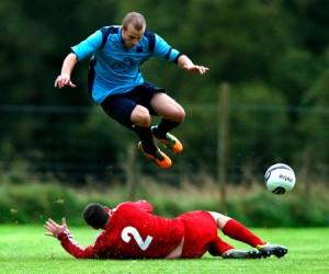 Richard Muir leaps high to evade this Calum MacRae challenge
