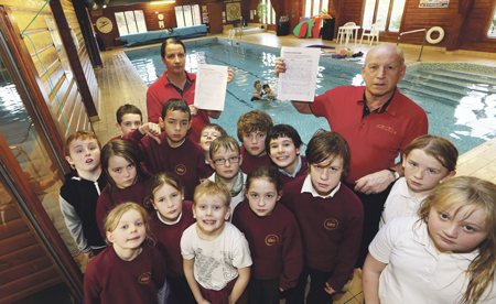 Leisure centre staff Charlene Maguire and Chris MacKinnon with pupils from Broadford Primary School