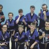 A group of happy Black Belts