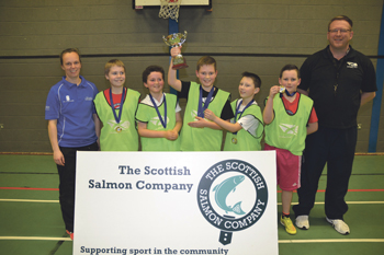 The winning Daliburgh Knicks team with Christine MacQuarrie from Active Schools and John Kerray, basketballscotland's regional development officer