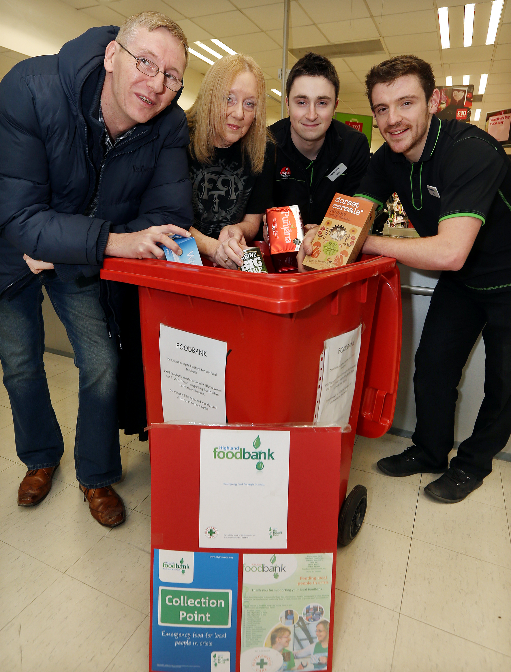 Foodbank members Andrew and Lynne Kearns pictured with Broadford Co-op staff Scott Thompson and Ben Yoxon