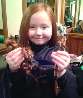 Willow shows off her locks after they were snipped off