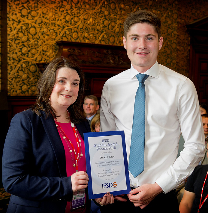 gStuart Gillies is presented with his 2016 IFSD Glasgow Student Award by Margaret Johnson, Executive Director, Human Resources, Morgan Stanley.