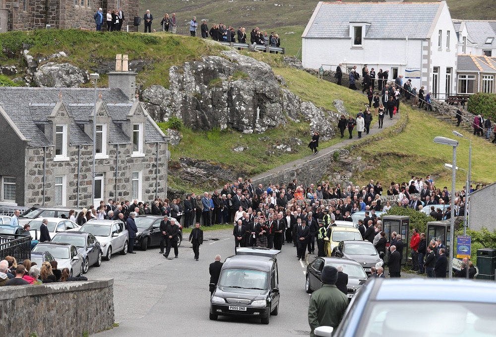 Mourners follow the funeral procession of Manchester bomb victim Eilidh MacLeod after the service at Church of Our Lady, Star of the Sea, in Castlebay on the island of Barra. ... Eilidh MacLeod funeral ... 05-06-2017 ... Barra ... UK ... Photo credit should read: Andrew Milligan/PA Wire. Unique Reference No. 31577249 ... Picture date: Monday June 5, 2017. The 14-year-old was among 22 people who died in the terrorist attack at the Ariana Grande concert on Monday May 22. See PA story FUNERAL Manchester. Photo credit should read: Andrew Milligan/PA Wire