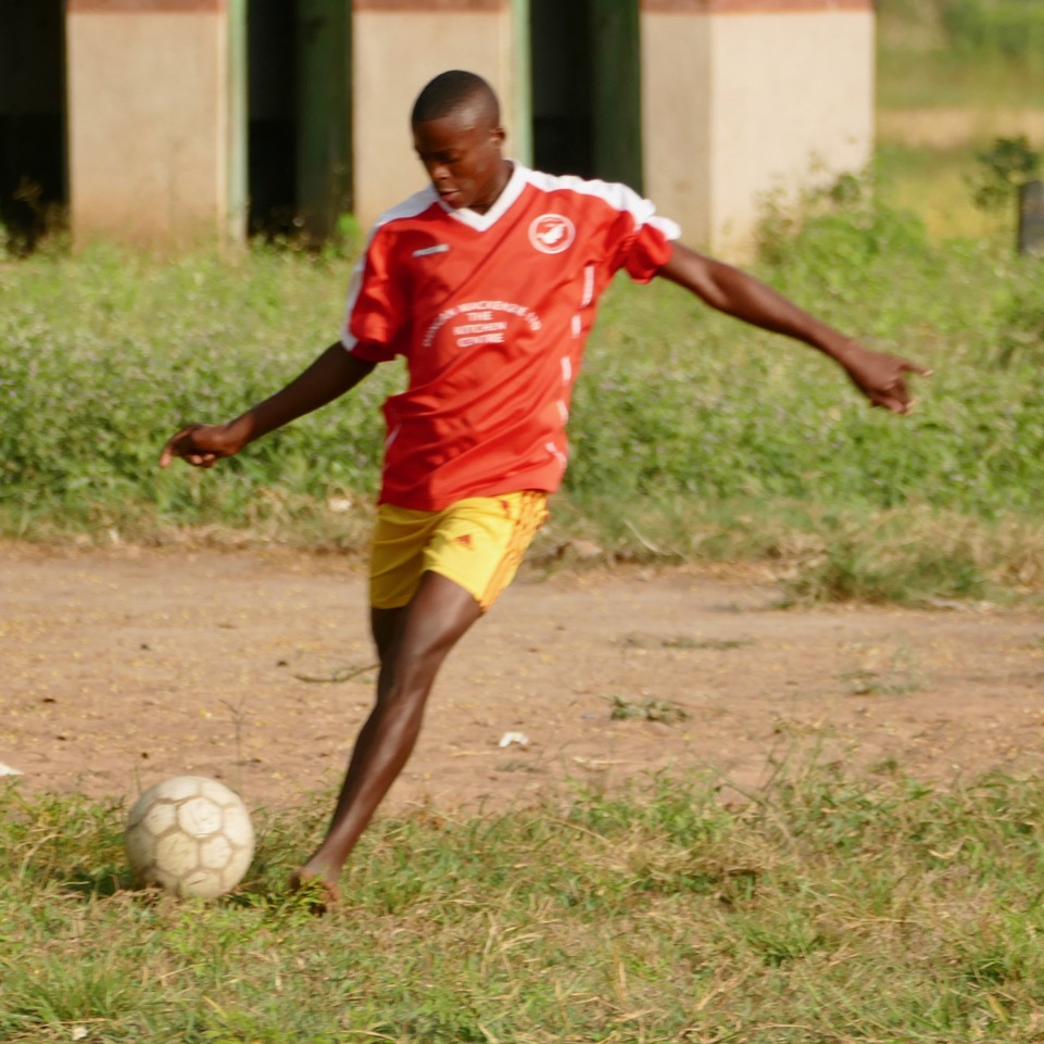 A barefoot Kiogosi player shows off his ball skills in his new Point top