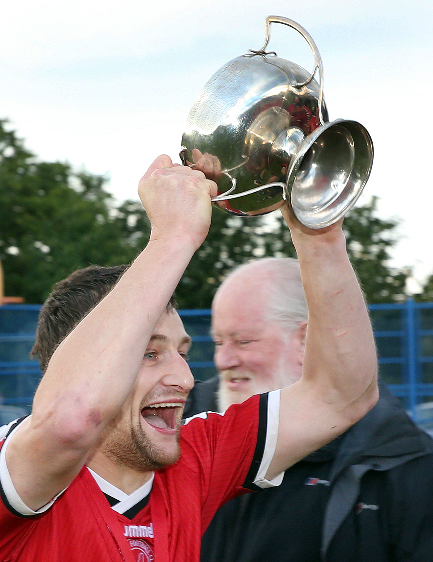 Michael Taylor lifts the Ross Cup which Kyleakin won with a 3-1 win over Sleat and Strath earlier this month