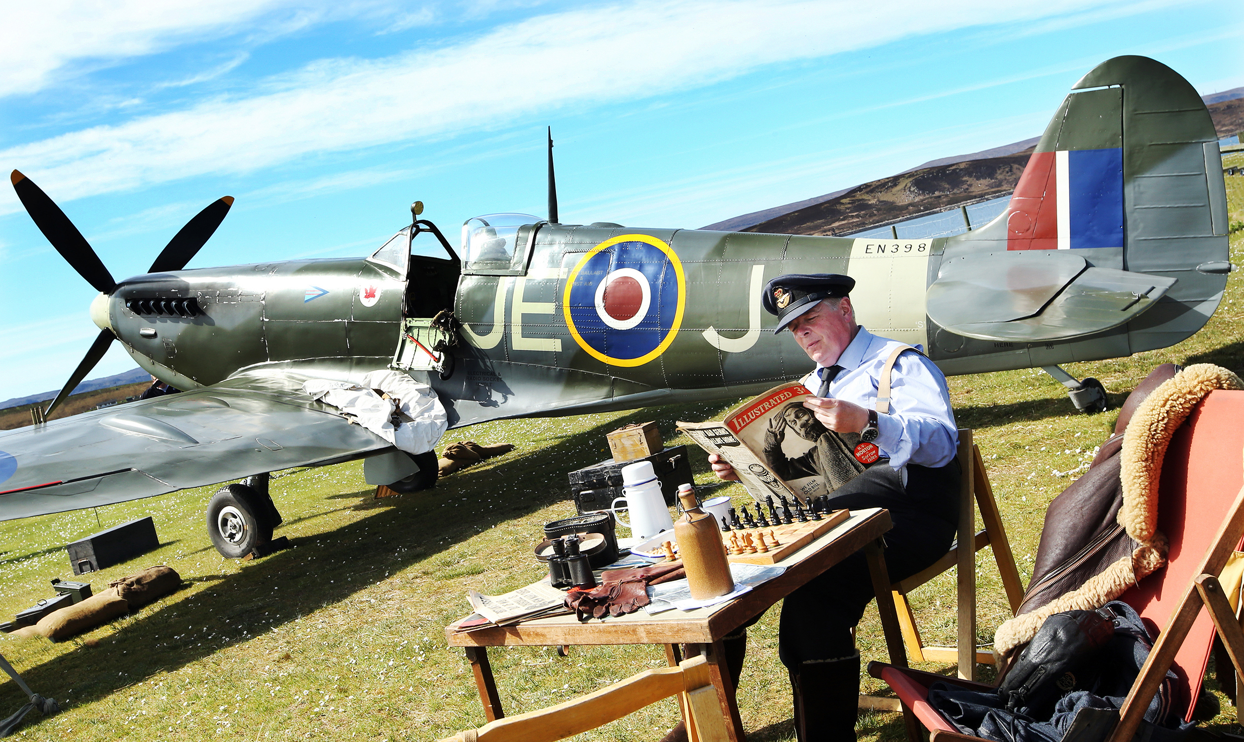 A replica Spitfire on display at the Battle of Britain camp in Aultbea, with pilot Mark Anthony Craig.