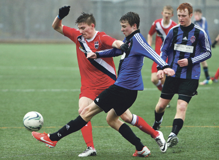 Defender Ryan O'Halloran puts in a typically committed tackle