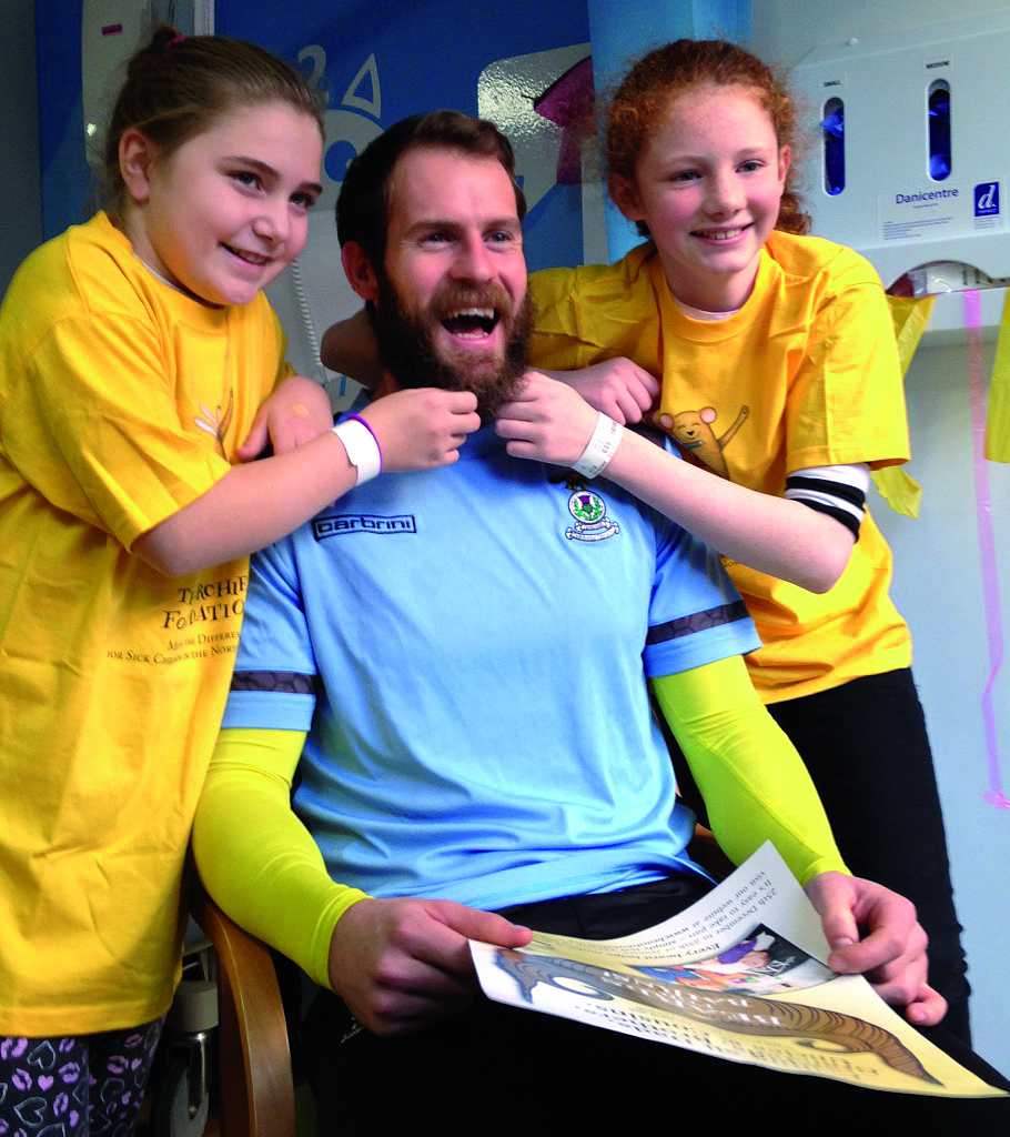 In-patients at the Highland Children's Unit Lakeisha Lapsley of Alness (left) and Eilidh Smith from Skye with Inverness Caley goalie Owain Fon Williams