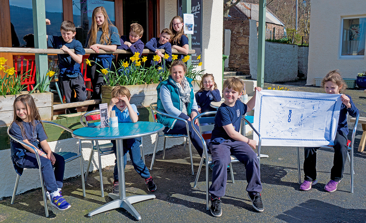 Pupils Francesca Hendriks, Cameron Hill, Maisie Fraser, Jack Fraser, Eoghain Sutherland, Jessica Hendriks, Bailey Dacker, Fraser Frost, Charlotte Fraser and Ciara Sutherland pictured outside Nanny's with head teacher Sarah MacDonald-Taylor
