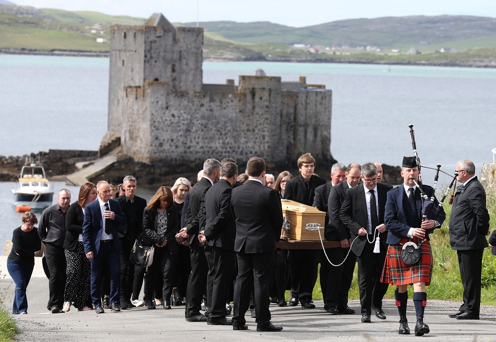 Roddy MacLeod father of Manchester bomb victim Eilidh MacLeod leads the funeral procession as it passes Kisimul Castle on its way to the Church of Our Lady, Star of the Sea, in Castlebay on the island of Barra. ... Eilidh MacLeod funeral ... 05-06-2017 ... Barra ... UK ... Photo credit should read: Andrew Milligan/PA Wire. Unique Reference No. 31575015 ... Picture date: Monday June 5, 2017. The 14-year-old was among 22 people who died in the terrorist attack at the Ariana Grande concert on Monday May 22. See PA story FUNERAL Manchester. Photo credit should read: Andrew Milligan/PA Wire