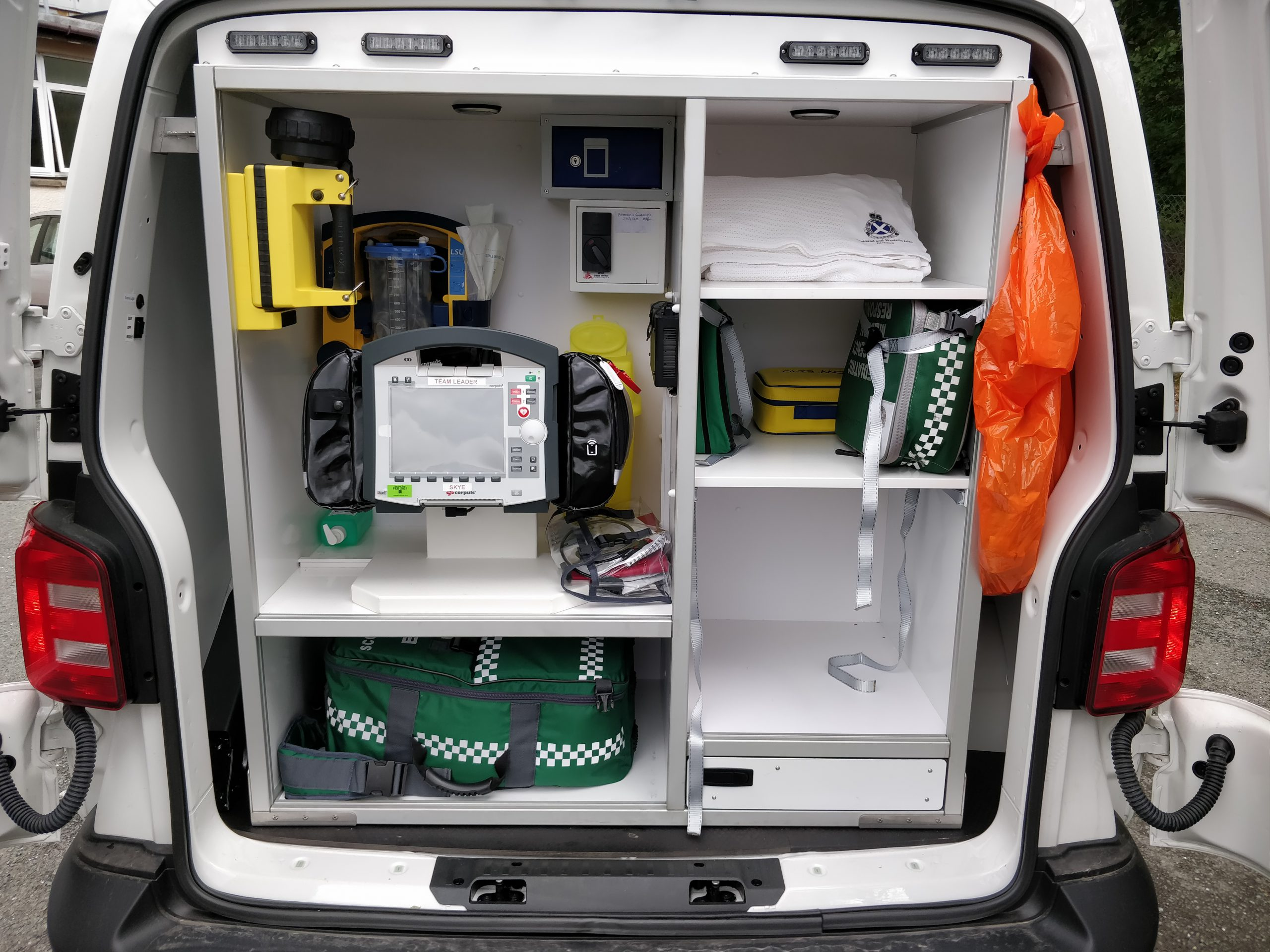 The rapid response unit as viewed from the back with the doors open. The equipment inside includes a defibrillator.