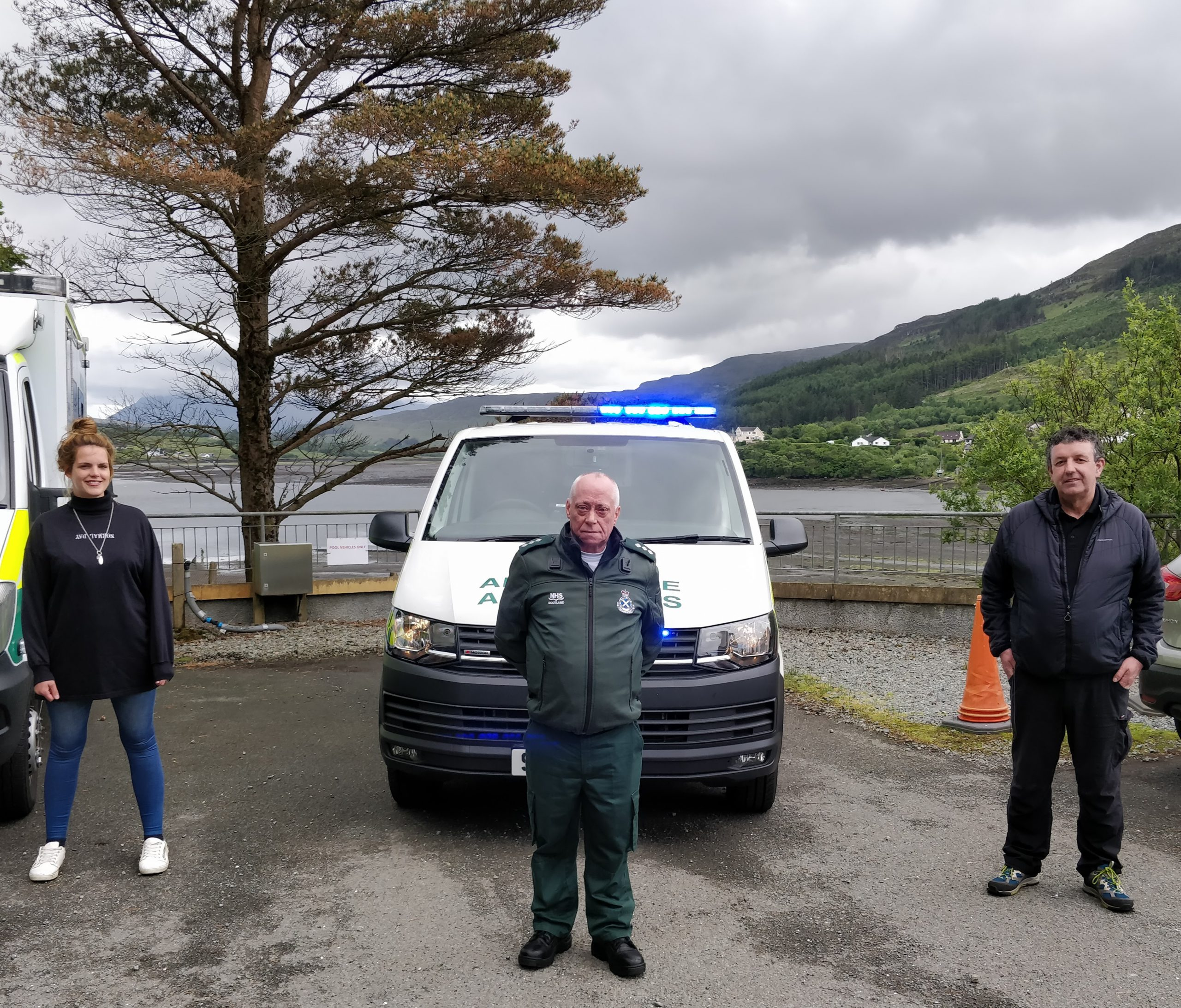 Sophie Isaacson from the Portree and Braes Community Trust, Alan Knox of the Scottish Ambulance Service, and Ross Cowie community lead for urgent care stand alongside the Rapid Response Unit at Portree Hospital, Skye.